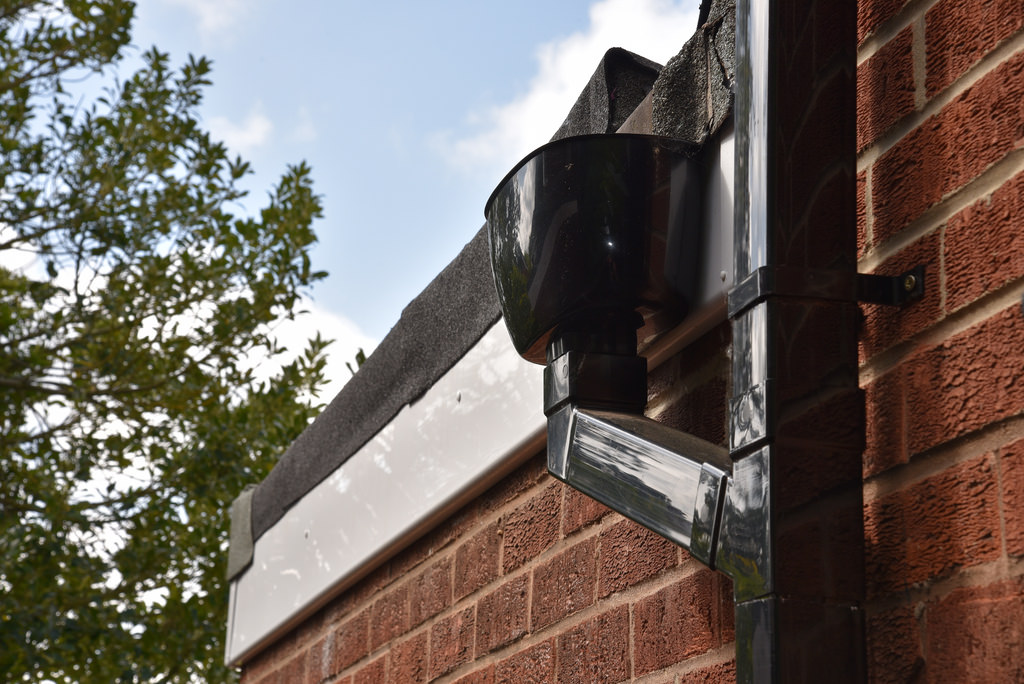 Metal Built In Gutter And A New Rubber Roof